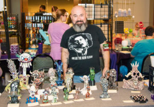 Artist sells art at SoonerCon 25.
